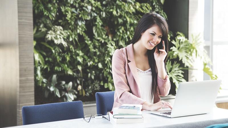 Work-Woman-Phone-Laptop-Smiling-800W